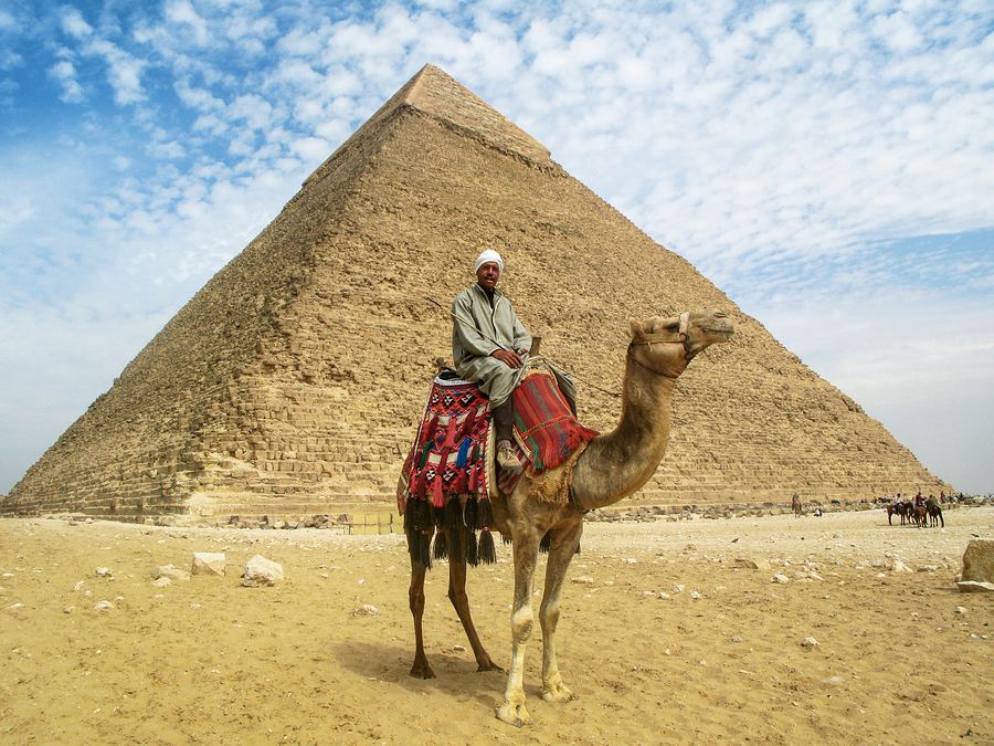 bigstock-Camel-Man-in-Front-of-Giza-Pyr-51847084